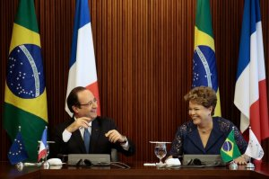 France's President Francois Hollande and Brazil's President Dilma Rousseff laugh during a signing ceremony at the Planalto Palace in Brasilia